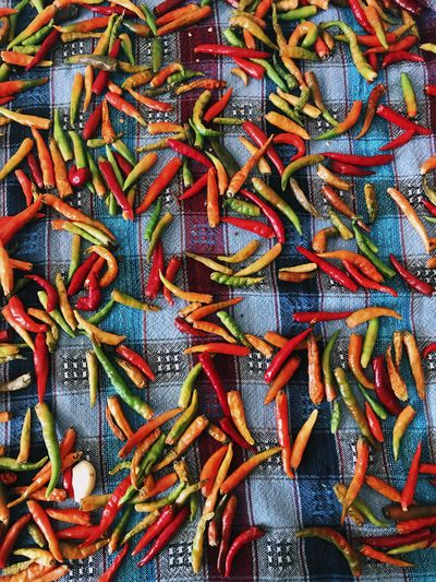 Full Frame Shot Of Chili Peppers On Tablecloth
