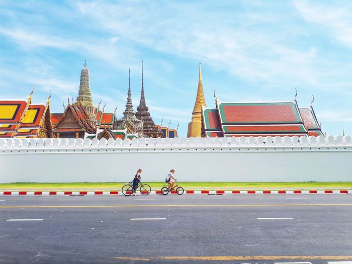 BANGKOK, THAILAND - April 16, 2019: Landmark, Wat Phra Kaew, Foreigners enjoying traveling to Phra Kaew Temple and cycling activities, Holiday concept Foreigner Landscape Temple Temple Architecture Travel Traveling Travel Photography Tourism Tourist Activity Blue Sky Summer Holiday Vacations Variation Pagoda Thailand Thailandtravel Thai Temple Thai History Historic Outdoor Beautiful ASIA Streetphotography City History Cityscape Architecture