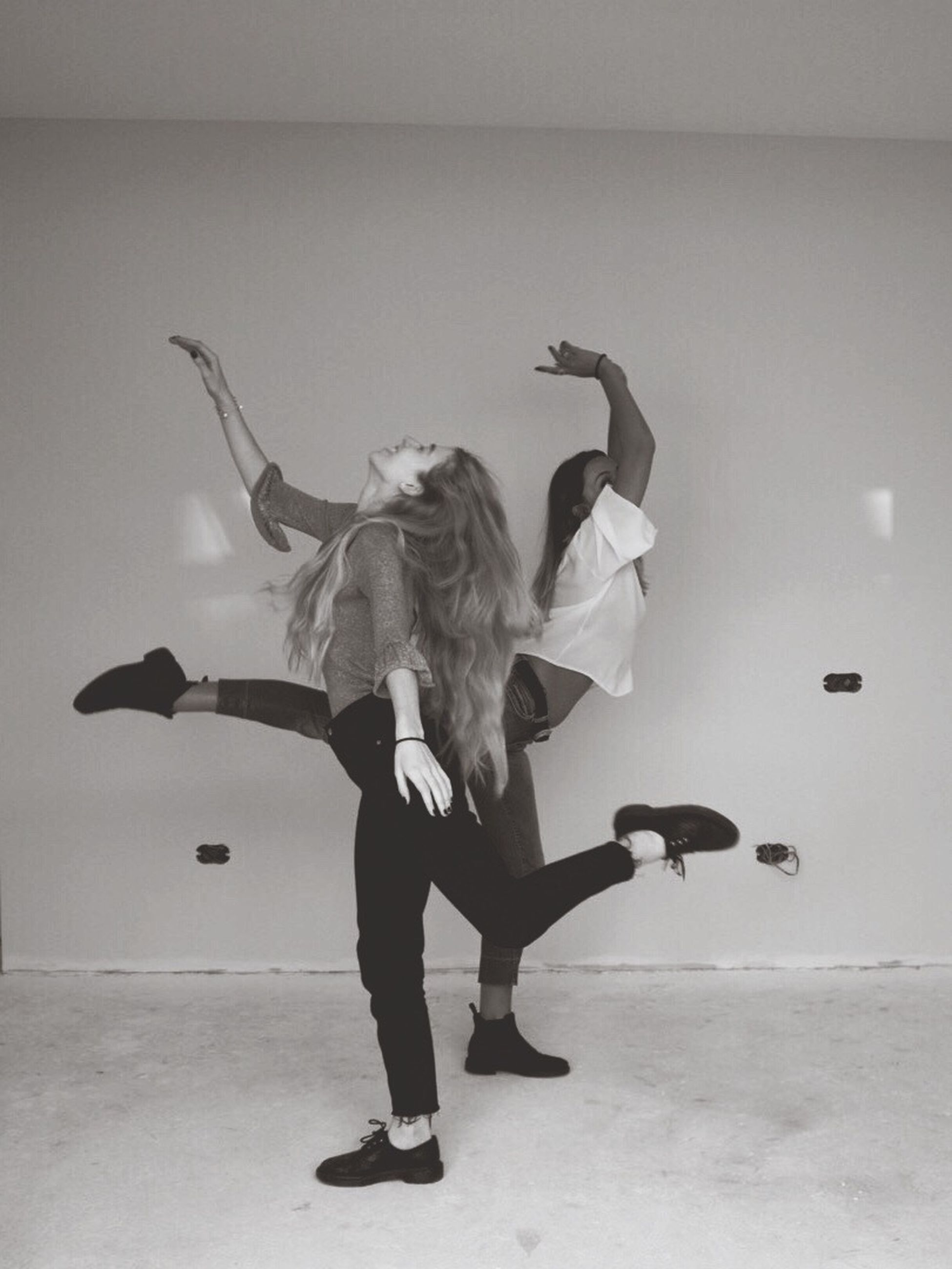 dancing, dancer, real people, leisure activity, performance, two people, fun, young women, balance, skill, full length, lifestyles, young adult, upside down, arts culture and entertainment, motion, flexibility, togetherness, women, indoors, handstand, ballet dancer, breakdancing, day, people
