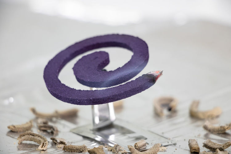 Close-up of mosquito coil on table