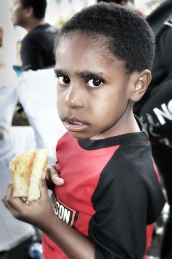 Close-up portrait of boy having food