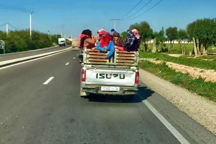 Passenger transportation at Tiznit in Morocco. Car Grass Morocco Passenger People Sky Street Tiznit Transportation Trees