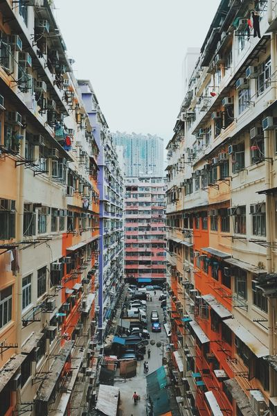 Architecture Building Exterior Car Built Structure Street City Clear Sky Transportation Sky Diminishing Perspective In A Row Day Outdoors Tall Multi Colored Tall - High Building Story No People City Life Development