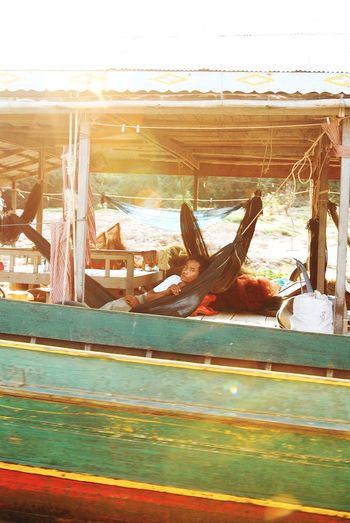 (2008 photo) I was on a boat, he was on a boat m. This boat is his home. 這船是他的家。 Open Edit Cambodia Tonlesap