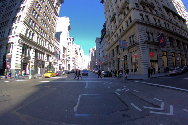 Architecture Building Exterior Built Structure City Clear Sky Day Fisheye Large Group Of People Looming Buildings Men New York City Outdoors People Real People Road Sky Street Transportation Ultra Wide Panoramic Views Walking