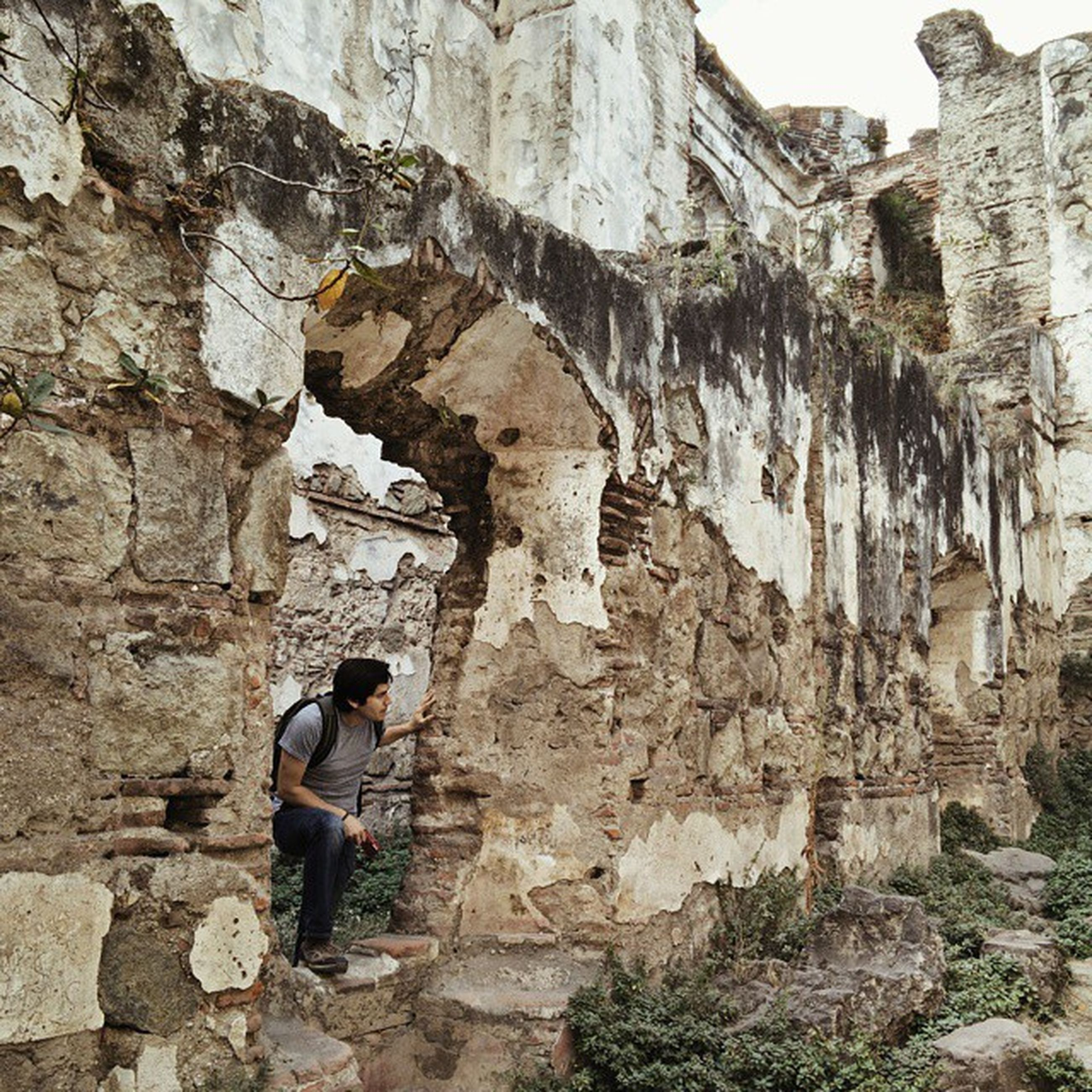 lifestyles, architecture, leisure activity, built structure, men, old ruin, stone wall, building exterior, history, person, full length, rock - object, old, ancient, tourist, travel, rock formation, the past