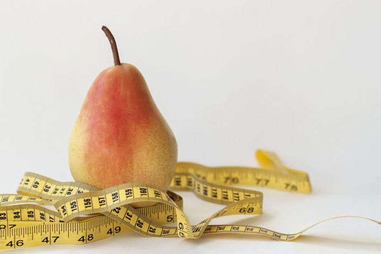 Ripe yellow pear and tape measure on light background, concept of a healthy lifestyle, diet, slim figure Healthy Eating Fruit Food And Drink Food Still Life Wellbeing Freshness Close-up No People Pear Tape Measure Ripe Yellow Healthy Lifestyle Healthy Healthy Food Bright Weight Figure Centimeter Energy Shape Calories Fitness