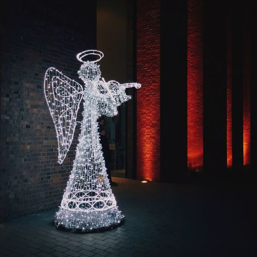 Illuminated Fairy Outside Building