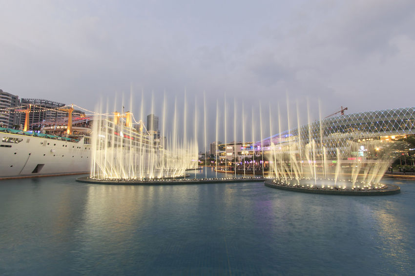 "Shenzhen, China - August 22,2015: Dancing Fountains in New Sea World Plaza, one of the landmark of Shenzhen, at sunset with the Minghua ship on its center. The ship was originally known as Anceevilla and was later renamed ""Minghua"" by the chinese who bought it. Amusement Park Ride Anceevilla ASIA Boat China City Cloud - Sky Cloudy Dancing Fountain Day Guandong City Mast Mode Of Transport Multi Colored Nature No People Outdoors Sailboat Shenzhen Shenzhen.China Sky Stock Market Tourism Travel Destinations Water"