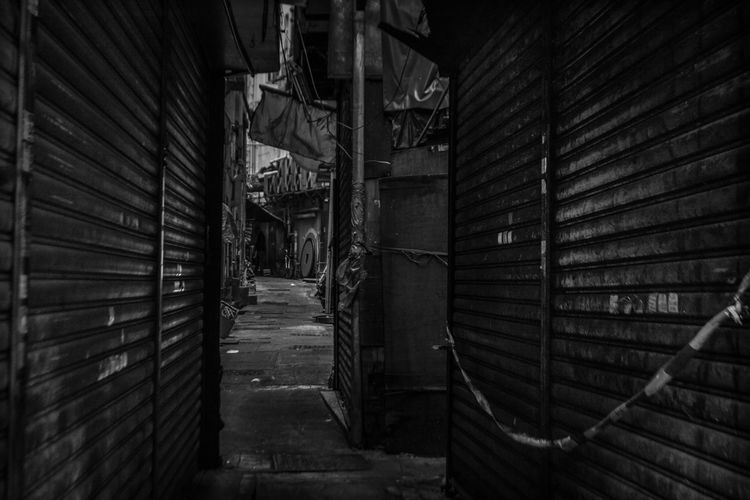 The Street Photographer - 2018 EyeEm Awards Abandoned Alley Architecture Building Built Structure Corrugated Iron Day Direction Indoors  Industry Iron Metal No People Old Shutter The Way Forward Wall Wall - Building Feature Wood - Material