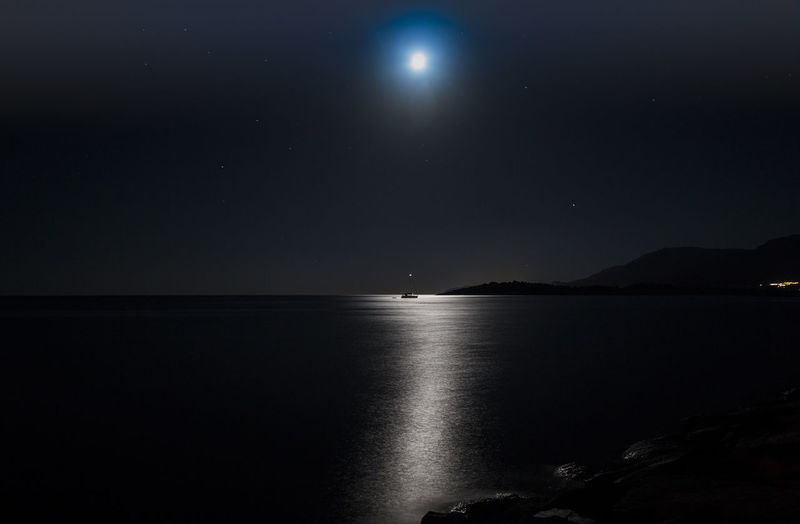 Moonlight over the sea Beauty In Nature Calm Dark Majestic Moon Moonlight Morning Nature Night Night Photography Nightphotography No People Ocean Reflection Reflections Reflections In The Water Scenics Sea Seascape Seascape Photography Tranquil Scene Tranquility Water Waterfront