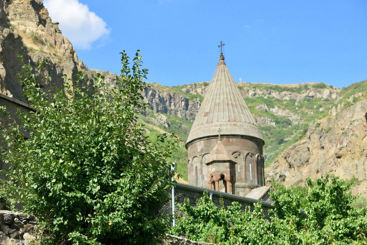 Armenia Armenian Church Geghard Geghard Monastery Architecture Beauty In Nature Building Exterior Built Structure Day Growth Mountain Nature No People Oriental Orthodox Church Outdoors Place Of Worship Plant Religion Sky Spirituality Tree W-armenien