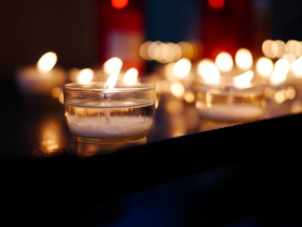 Candle Illuminated Cold Temperature Table Defocused Close-up