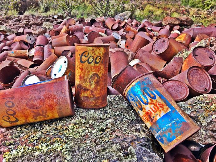 An old miners hangout in the Colorado Rockies from the 60's. Old beer and spam cans. Coors RustyCan Rusty Colorado Mountians Miners Town Beercans Day Large Group Of Objects No People Nature Abundance Text Outdoors