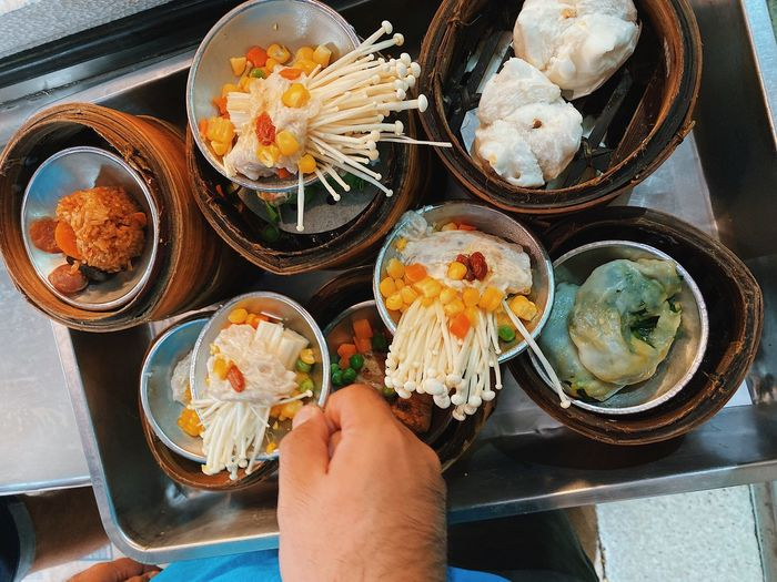High angle view of hand holding food