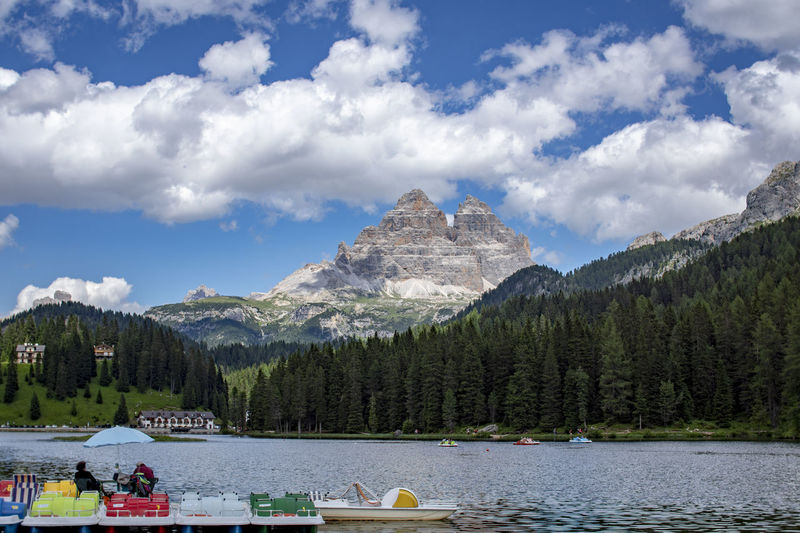 Beauty In Nature Cloud - Sky Day Group Of People Lake Misurina Lake Mode Of Transportation Mountain Mountain Range Nature Nautical Vessel Outdoors Plant Scenics - Nature Sky Transportation Travel Tree Water Waterfront