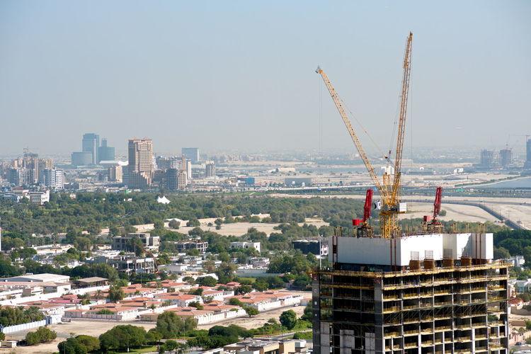 Aerial view of buildings against clear sky