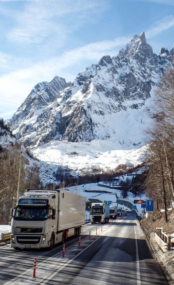 Transportation Mountain Winter Snow Cold Temperature Mode Of Transportation Motor Vehicle Road Land Vehicle Snowcapped Mountain Sky Mountain Range Car Cloud - Sky Scenics - Nature Beauty In Nature Nature Day No People Outdoors Formation Mountain Peak