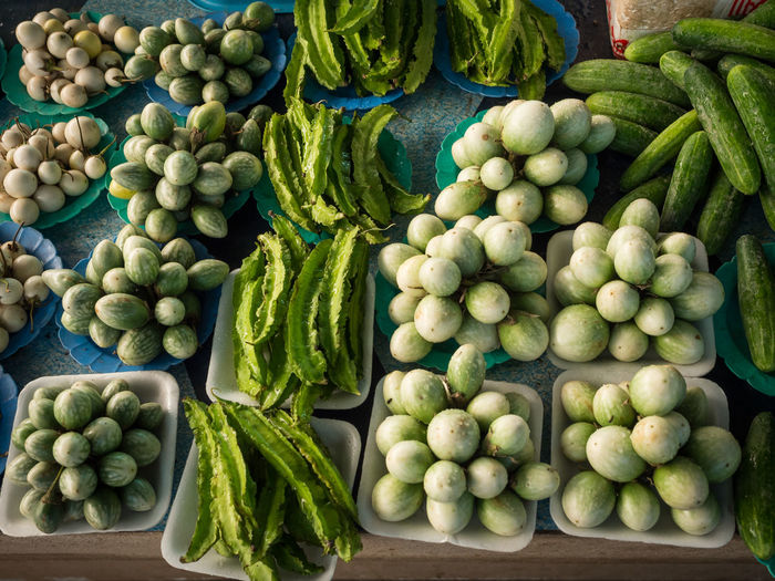 Fresh green vegetables on Thai market Aubergine Chiang Mai Eggplant Thailand Travel Abundance Business Choice Consumerism Food Food And Drink For Sale Freshness Green Color Healthy Eating Large Group Of Objects Market Market Stall No People Order Outdoors Raw Food Retail  Retail Display Sale Small Business Variation Vegetable Wellbeing