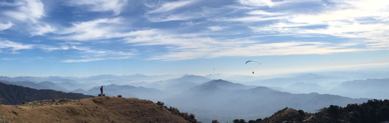 Go Higher Mountain Scenics Nature Beauty In Nature Mountain Range Adventure Sky Leisure Activity Real People Cloud - Sky Parachute Paragliding Extreme Sports One Person Day Landscape Tranquility Outdoors Tree Tranquil Scene