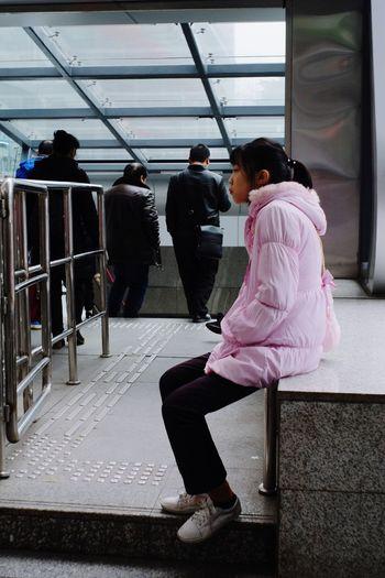 Rear view of women sitting in bus