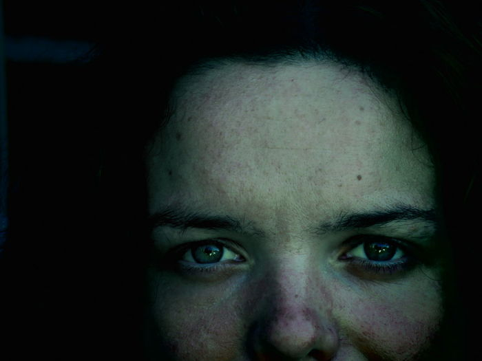 Close-up portrait of woman with freckle