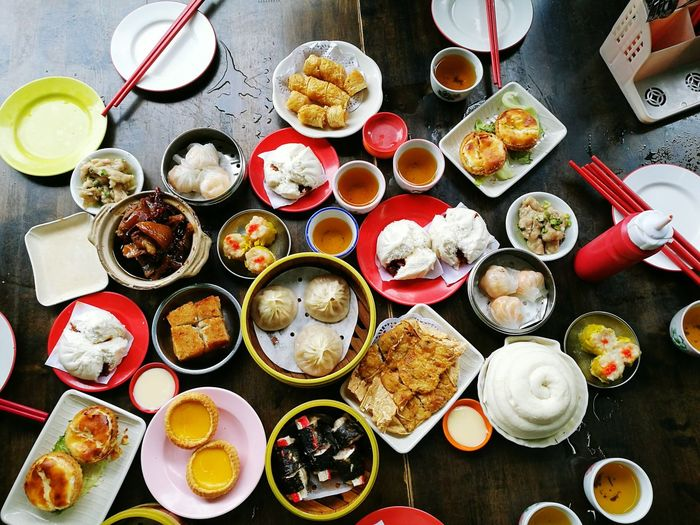 High Angle View Of Various Food Served On Table