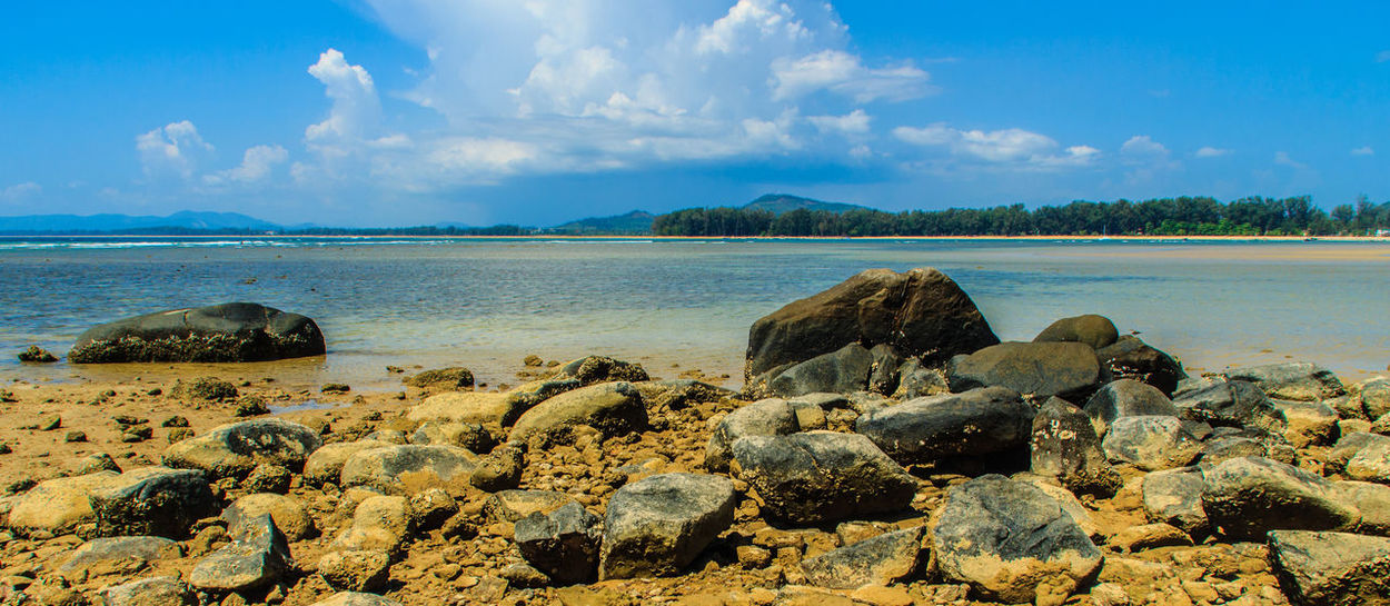 Beautiful rock stones on the beach when the sea water receded with dramatic blue sky background on the cloudy day. Rock Rocky Rocky Beach Rocky Beach Cove Rocky Beach Panoramic View Rocky Coastline Rocky Shore Beach Beauty In Nature Blue Sky Blue Sky And Clouds Cloud - Sky Day Horizon Over Water Nature No People Outdoors Pebble Beach Rock - Object Rock Beach Rocky Beach With Sand Rocky Landscape Scenics Sea Sky Stone Beach Stones Tranquil Scene Tranquility Water