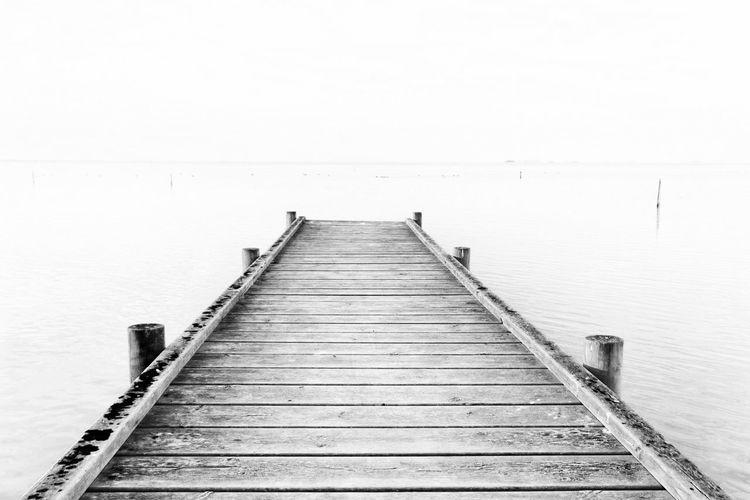 Silence Minimalism Blackandwhite Delta De L'Ebre Water Lake Jetty Wood - Material Wood Paneling Beach Pier Sky Horizon Over Water vanishing point Seascape Harbor Dock The Minimalist - 2019 EyeEm Awards
