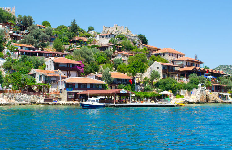 Architecture Building Exterior Built Structure Community Day Exterior House Human Settlement Moored Nautical Vessel Outdoors Ramble Reflection Residential Building Residential District Residential Structure Roof Summertime Tour Town Trip Tropical Climate Turkey Vacation Water