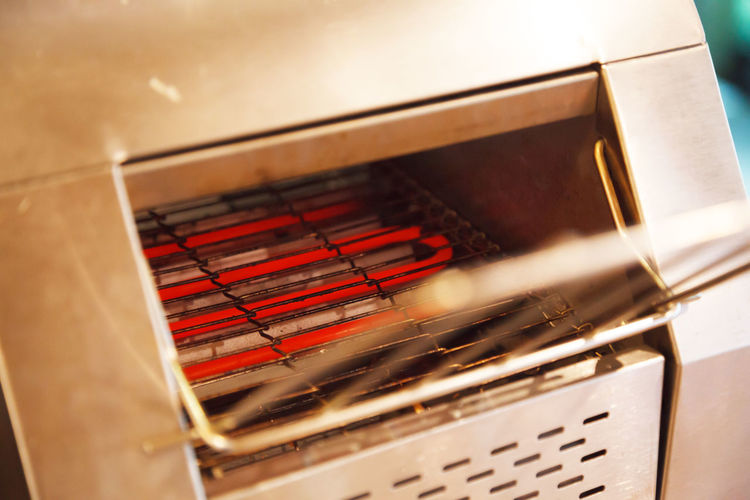 Electrical Conveyor Toaster Oven toasting is operated by applying heat, from hot coil element heating source in oven chamber, to toast on automatic feeding belt. Food Catering Service Industry concept Heat - Temperature Metal Toasted Bread Toasting Hot Belt  Feeding  Conveyor Belt Conveyor Toaster Oven Conveyor Toaster Bakery Food Catering Service Hotel Restaurant Heating Warm Breakfast Meal Machine Equipment Heat Conduction Appliance Electrical