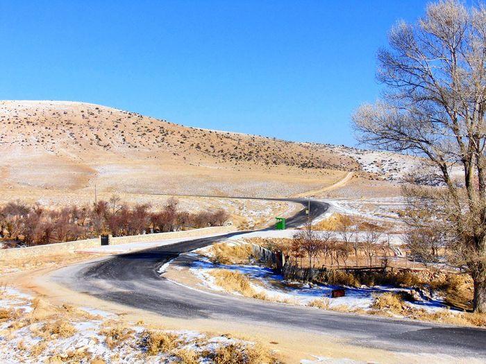 Narrow Road Along Countryside Landscape