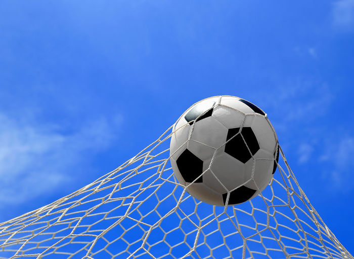 Ball Blue Day Football Goal Nature Net - Sports Equipment No People Outdoors Pattern Playing Playing Field Scoring Sky Soccer Soccer Ball Soccer Field Soccer Team  Sport Sports Equipment Team Sport