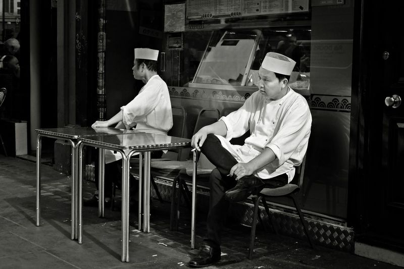 Pause Time. Smocking Time Smoke Work Workers Chef Lifestyles Men Mid Adult Occupation Pause People Real People Seat Sitting Smocking Two People Uniform