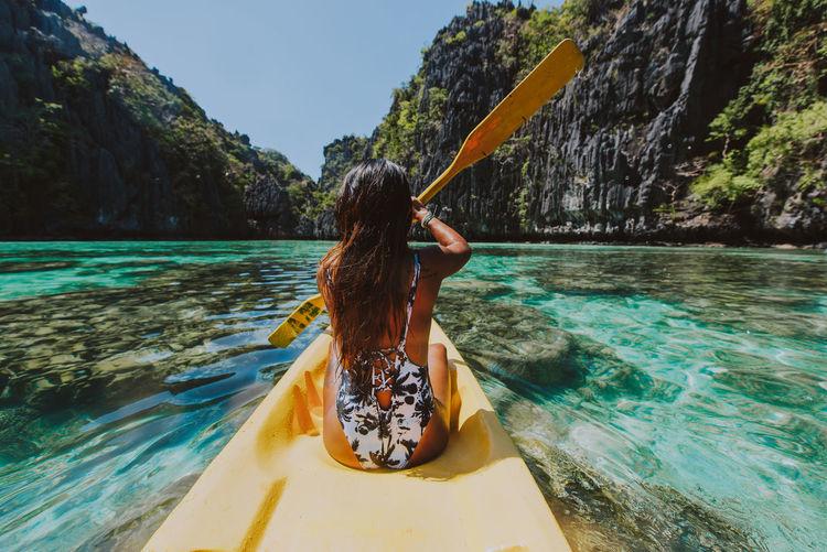 Woman in swimming pool by sea