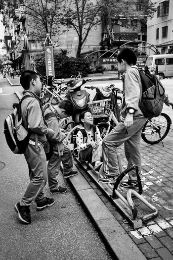 Boys Eye4photography Pastel Faces Of EyeEm Mirrorless Faces Of The World Everyday Lives I Like My City Streetphotography People I Love My City People Together Taking Photos Black & White Children Photography Kidsphotography Everybodystreet EyeEm Diversity EyeEmNewHere
