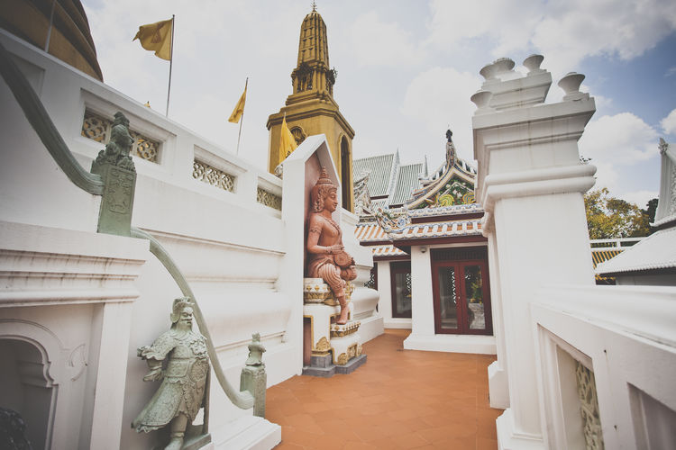 a temple in Thailand Architectural Feature Architecture Buddhism Buddhist Buddhist Temple Built Structure Cloud - Sky Day Famous Place History Memories Outdoors Place Of Worship Religion Sky Spirituality Temple - Building The Way Forward Tourism