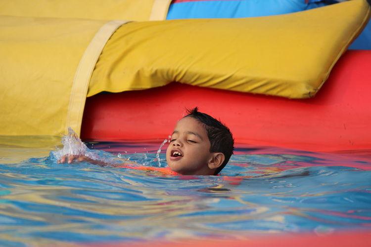 Cute boy in swimming pool