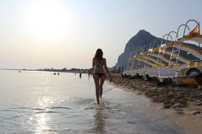 Italy Sicily Water Sky Real People One Person Sea Standing Leisure Activity Nature Beauty In Nature Women Scenics - Nature Sunset Adult Clear Sky Outdoors Rear View Full Length Lifestyles Beach