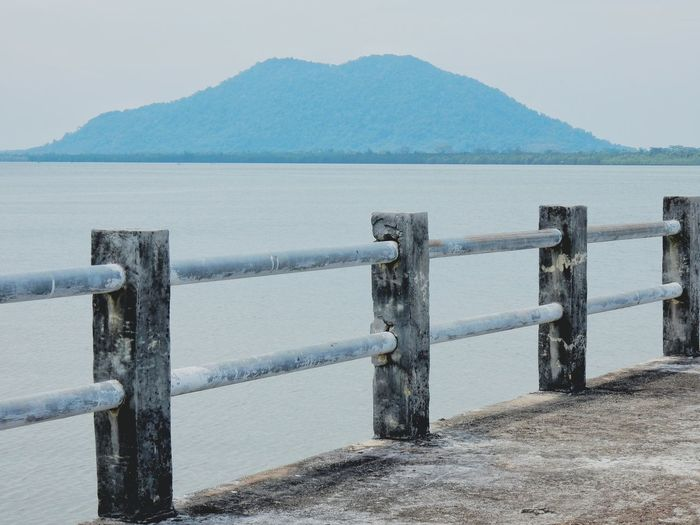 Mountain Water Tranquil Scene Mountain Range Scenics Tranquility Sea Clear Sky Idyllic Wooden Post Non-urban Scene Beauty In Nature Nature Mountain Peak Sky Remote In Front Of Majestic Shore The Way Forward Jetty Bridge