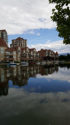 Delta Hotels In Kelowna Reflection Water Nautical Vessel City Scenics Outdoors Okanagan Lake Vacations Travel Destinations Boats Okanagan Hotel Kelowna, City Life Enjoying The Sights Breathing Space Investing In Quality Of Life No People Architecture Tranquility
