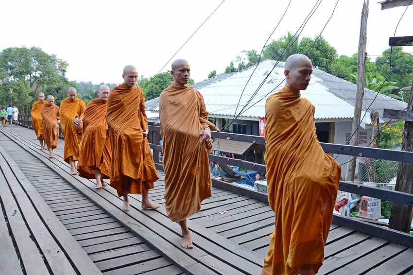 Monk on wooden bridge in sangkhlaburi kanchanaburi Religion Spirituality Adult Outdoors People Only Men Group Of People Portrait Adults Only Real People Men Monk  Tradition Buddha Buddhist Sangkhlaburi Kanchanaburi Wooden Bridge