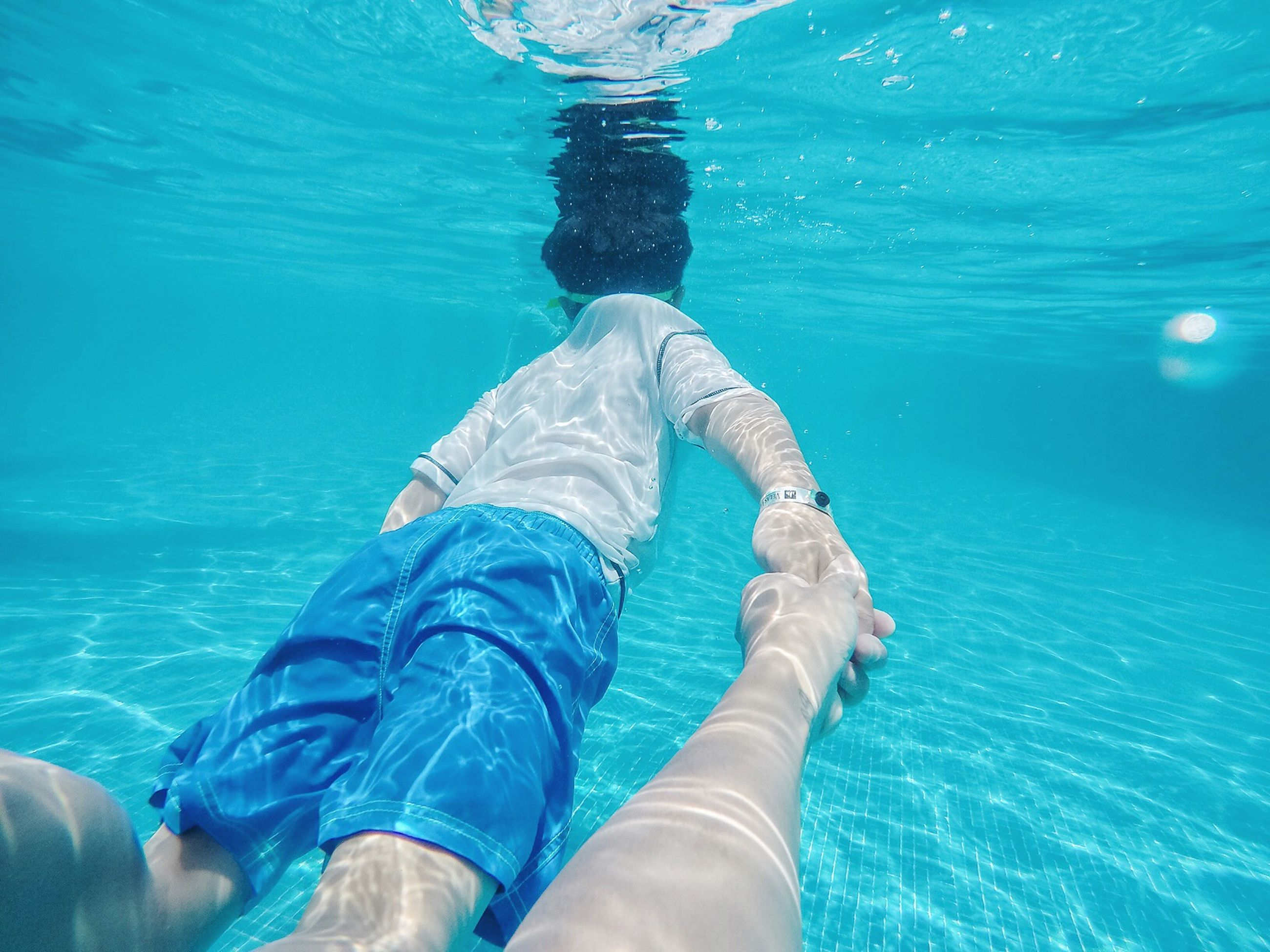water, blue, low section, swimming, person, underwater, swimming pool, leisure activity, lifestyles, sea, men, personal perspective, turquoise colored, high angle view, rippled, animal themes, unrecognizable person