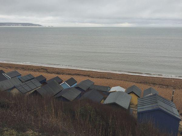 Beach Beach Huts Seaside Coast Overcast Sea The Needles Isle Of Wight