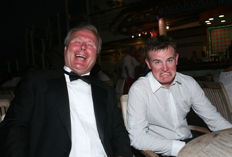 Dad and son sharing a joke together Bonding Friendship Gurning Gurning Face Happiness Happiness Happy People Having A Good Time Having A Laugh Lifestyles Looking At Camera Mature Adult Mid Adult Mid Adult Men Night Person Portrait Sitting Smiling Togetherness Toothy Smile Waist Up Young Adult Young Men