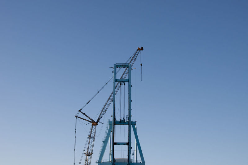 Dockside Crane Architecture Blue Built Structure Clear Sky Construction Construction Site Copy Space Crane - Construction Machinery Day Development Dock Electricity  Low Angle View Metal No People Outdoors Ship SPAIN Sunlight