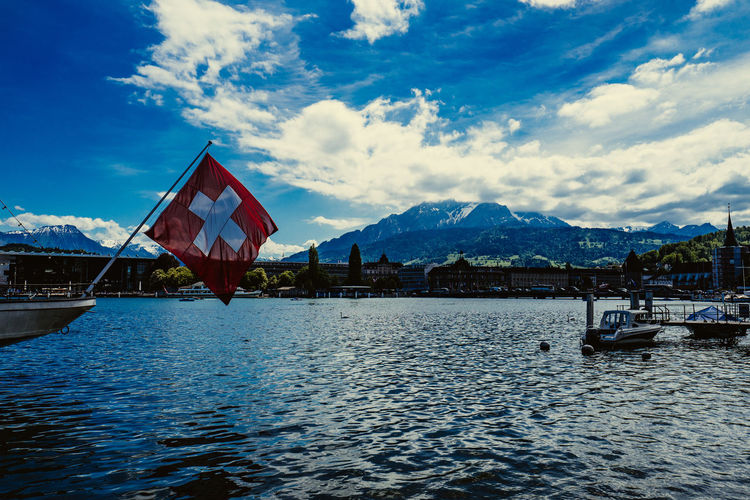 Flag In Boat With Mountain In Background