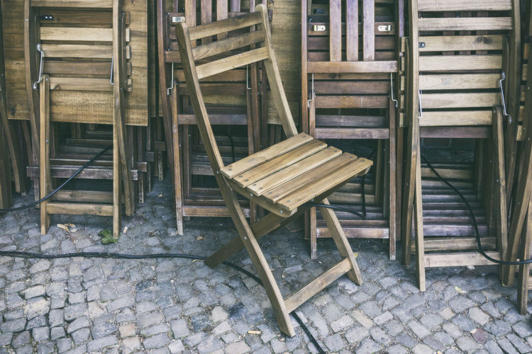 High angle view of wooden chairs