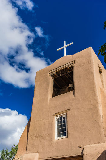 San Miguel Mission in Santa Fe, New Mexico Adobe Church Mission Architecture Bell Tower Building Exterior Built Structure Cloud - Sky Cross Day Low Angle View Nature No People Outdoors Place Of Worship Religion Sky Spirituality