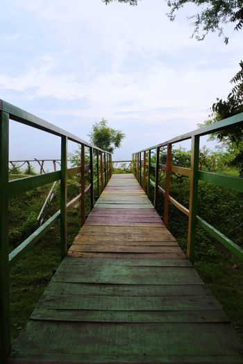 Watu Layar exotic place in Lasem, Indonesia Architecture Bridge Built Structure Cloud - Sky Connection Day Diminishing Perspective Direction Footbridge Footpath Land Long Nature No People Outdoors Plant Railing Sky The Way Forward Tree Wood Wood - Material Wood Paneling